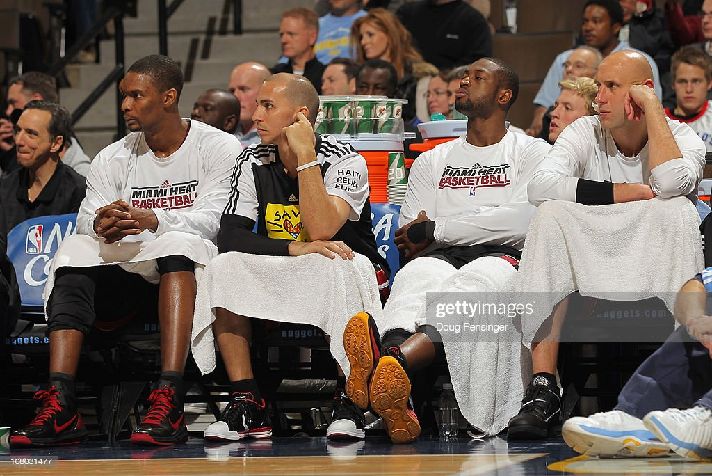 Chris Bosh #1, Carlos Arroyo #8, Dwyane Wade #3 and Zydrunas Ilgaukas #11 of the Miami Heat sit on the bench in the fourth quarter against the Denver Nuggets at the Pepsi Center on January 13, 2011 in Denver, Colorado. The Nuggets defeated the Heat 130-102.