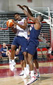 Chris Bosh drives against Dwight Howard in a scrimmage during USA Senior Mens National Team practice on July 22 2006 at the Cox Pavilion in Las Vegas...