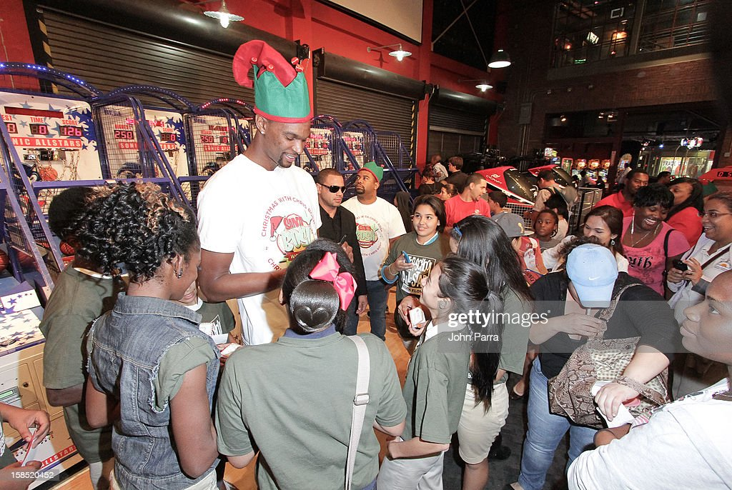 <a gi-track='captionPersonalityLinkClicked' href=/galleries/search?phrase=Chris+Bosh&family=editorial&specificpeople=201574 ng-click='$event.stopPropagation()'>Chris Bosh</a> (C) during the Christmas With <a gi-track='captionPersonalityLinkClicked' href=/galleries/search?phrase=Chris+Bosh&family=editorial&specificpeople=201574 ng-click='$event.stopPropagation()'>Chris Bosh</a> At 'Santa Bosh's Workshop at Game Time at Sunset Place on December 17, 2012 in Miami, Florida.
