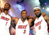 Chris Bosh Dwyane Wade and LeBron James of the Miami Heat are introduced at the HEAT Summer of 2010 Welcome Event at AmericanAirlines Arena on July 9...