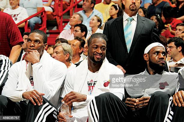 Chris Bosh Dwyane Wade and LeBron James of the Miami Heat look on from the bench during a game between the Chicago Bulls and the Miami Heat on April...