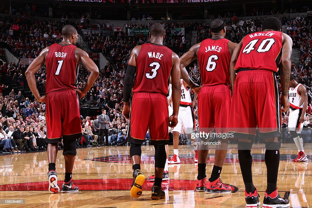 Chris Bosh #1, Dwyane Wade #3, LeBron James #6 and Udonis Haslem #40 of the Miami Heat rest during a timeout against the Portland Trailblazers on January 10, 2013 at the Rose Garden Arena in Portland, Oregon.