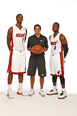 Chris Bosh Head Coach Eric Spoelstra and Dwyane Wade of the Miami Heat pose for a portrait during 2014 Media Day at the America Airlines Arena in...