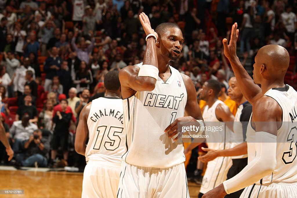 <a gi-track='captionPersonalityLinkClicked' href=/galleries/search?phrase=Chris+Bosh&family=editorial&specificpeople=201574 ng-click='$event.stopPropagation()'>Chris Bosh</a> #1 high fives teammate <a gi-track='captionPersonalityLinkClicked' href=/galleries/search?phrase=Ray+Allen&family=editorial&specificpeople=201511 ng-click='$event.stopPropagation()'>Ray Allen</a> #34 of the Miami Heat who hit the go ahead three pointer against the Cleveland Cavaliers on November 24, 2012 at American Airlines Arena in Miami, Florida.