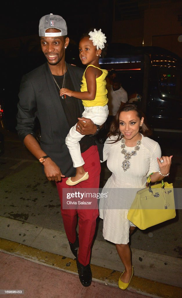 <a gi-track='captionPersonalityLinkClicked' href=/galleries/search?phrase=Chris+Bosh&family=editorial&specificpeople=201574 ng-click='$event.stopPropagation()'>Chris Bosh</a>, his wife <a gi-track='captionPersonalityLinkClicked' href=/galleries/search?phrase=Adrienne+Bosh&family=editorial&specificpeople=7508479 ng-click='$event.stopPropagation()'>Adrienne Bosh</a> is sighted at Prime 112 Steakhouse on June 3, 2013 in Miami Beach, Florida.