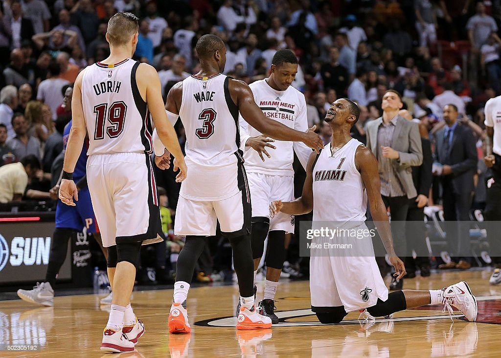 Chris Bosh is helped up by Dwyane Wade of the Miami Heat after missing the winning shot during a game against the Detroit Pistons at American...