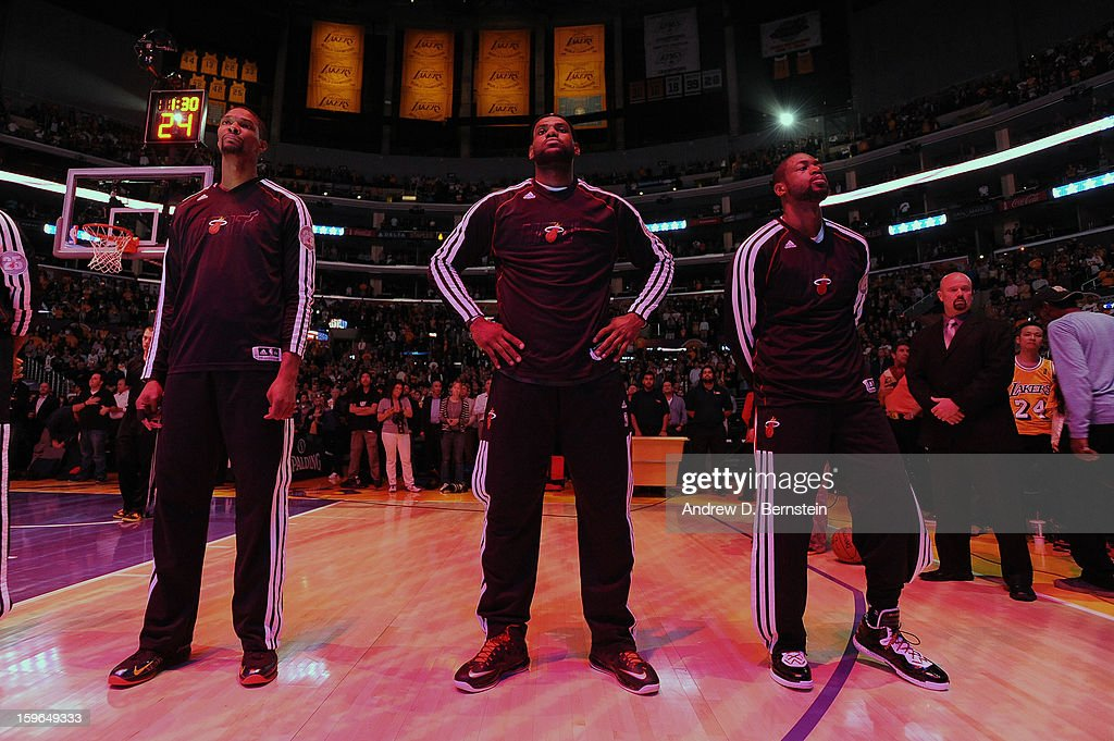 Chris Bosh #1, LeBron James #6, and Dwyane Wade #3 of the Miami Heat look on during the performance of the National Anthem before taking on the Los Angeles Lakers at Staples Center on January 15, 2013 in Los Angeles, California.