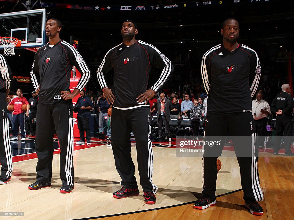 Chris Bosh #1, LeBron James #6 and Dwyane Wade #3 of the Miami Heat stand during the national anthem pre-game against the Washington Wizards during the game at the Verizon Center on December 4, 2012 in Washington, DC.