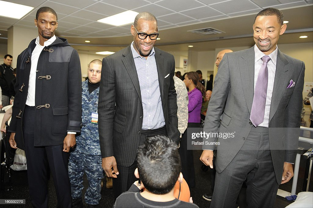 Chris Bosh, LeBron James and Juwan Howard of the Miami Heat meet family member of servicemen during a visit to Walter Reed National Military Medical Center on January 28, 2012 Bethesda, MD.