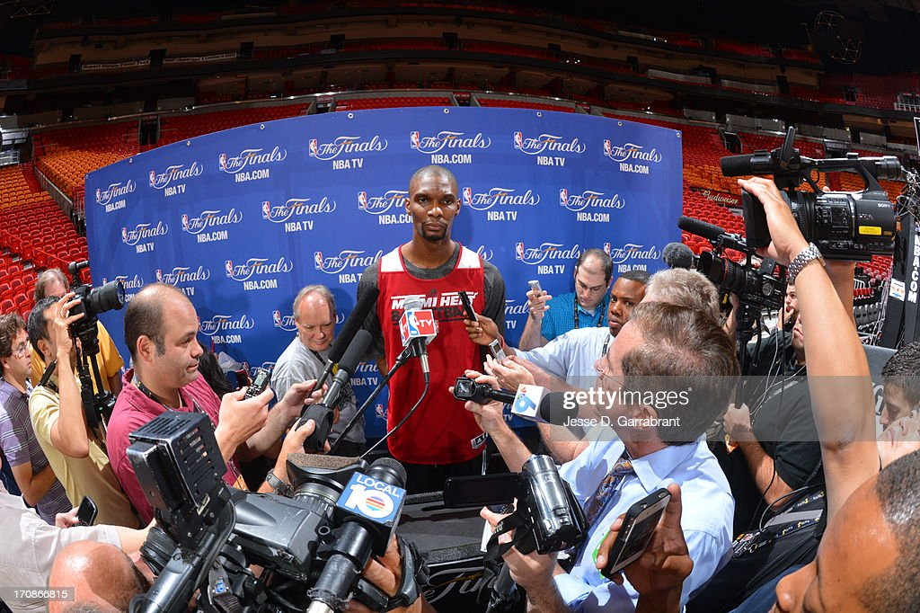 <a gi-track='captionPersonalityLinkClicked' href=/galleries/search?phrase=Chris+Bosh&family=editorial&specificpeople=201574 ng-click='$event.stopPropagation()'>Chris Bosh</a> of the Miami Heat addresses the media as part of the 2013 NBA Finals on June 19, 2013 at American Airlines Arena in Miami, Florida.