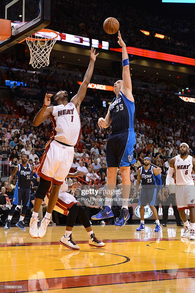 Chris Bosh #1 of the Miami Heat and Chris Kaman #35 of the Dallas Mavericks in action during a NBA game on January 2, 2013 at American Airlines Arena in Miami, Florida.