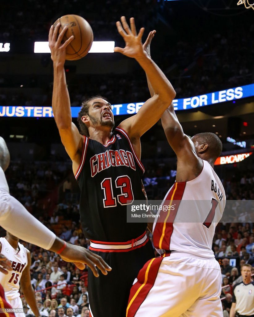 Chris Bosh #1 of the Miami Heat and Joakim Noah #13 of the Chicago Bulls fight for position during a game at AmericanAirlines Arena on January 4, 2013 in Miami, Florida.