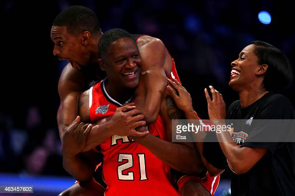 Chris Bosh of the Miami Heat and the Eastern Conference celebrates with NBA Legend Dominique Wilkins and Swin Cash of the New York Liberty after...