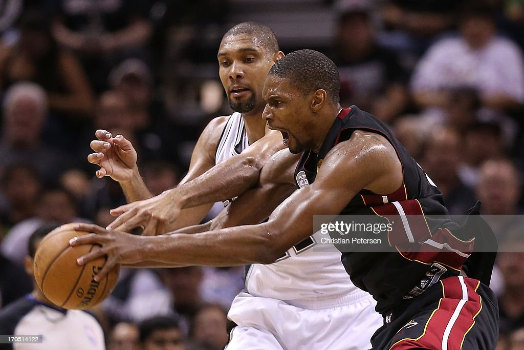 Chris Bosh #1 of the Miami Heat and Tim Duncan #21 of the San Antonio Spurs go after the ball in the fourth quarter during Game Four of the 2013 NBA Finals at the AT&T Center on June 13, 2013 in San Antonio, Texas.