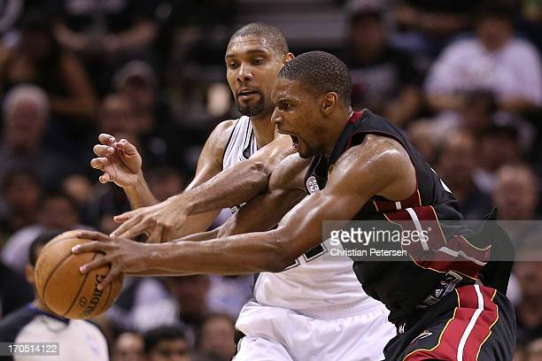 Chris Bosh of the Miami Heat and Tim Duncan of the San Antonio Spurs go after the ball in the fourth quarter during Game Four of the 2013 NBA Finals...