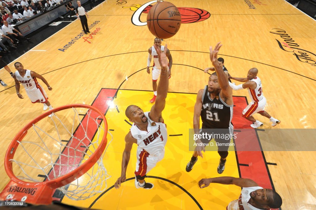 Chris Bosh #1 of the Miami Heat and Tim Duncan #21 of the San Antonio Spurs go for a rebound during Game Six of the 2013 NBA Finals on June 18, 2013 at the American Airlines Arena in Miami, Florida.