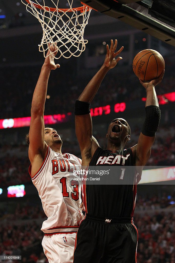 Chris Bosh #1 of the Miami Heat attempts a shot in the first quarter against Joakim Noah #13 of the Chicago Bulls in Game One of the Eastern Conference Finals during the 2011 NBA Playoffs on May 15, 2011 at the United Center in Chicago, Illinois.