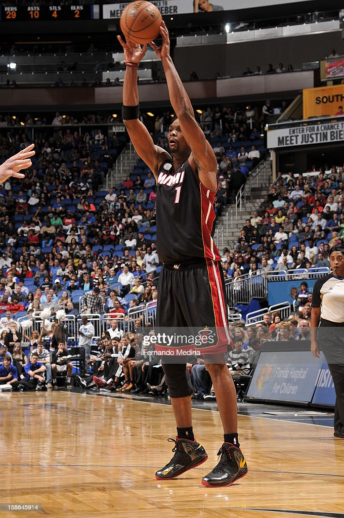 Chris Bosh #1 of the Miami Heat attempts to pass the ball downlow against the Orlando Magic during the game on December 31, 2012 at Amway Center in Orlando, Florida.