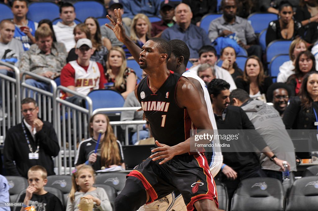 Chris Bosh #1 of the Miami Heat backs up to the basket against the Orlando Magic during the game on December 31, 2012 at Amway Center in Orlando, Florida.