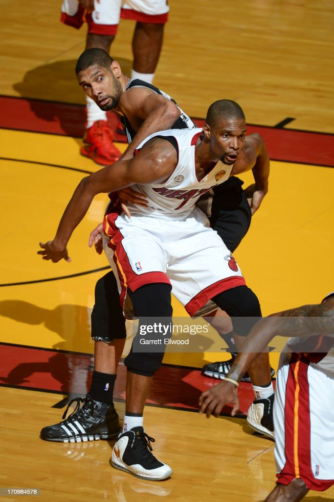Chris Bosh #1 of the Miami Heat battles for positioning against Tim Duncan #21 of the San Antonio Spurs during Game Seven of the 2013 NBA Finals on June 20, 2013 at American Airlines Arena in Miami, Florida.