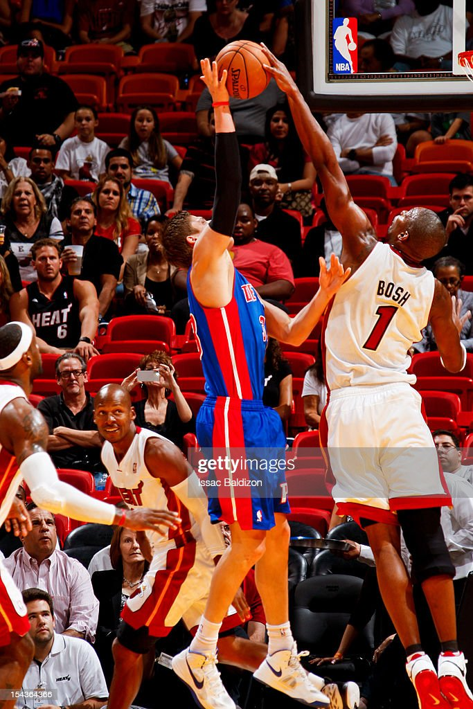 <a gi-track='captionPersonalityLinkClicked' href=/galleries/search?phrase=Chris+Bosh&family=editorial&specificpeople=201574 ng-click='$event.stopPropagation()'>Chris Bosh</a> #1 of the Miami Heat blocks a shot attempt by <a gi-track='captionPersonalityLinkClicked' href=/galleries/search?phrase=Jonas+Jerebko&family=editorial&specificpeople=5942357 ng-click='$event.stopPropagation()'>Jonas Jerebko</a> #33 of the Detroit Pistons during a pre-season game on October 18, 2012 at American Airlines Arena in Miami, Florida.