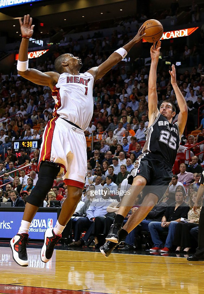 Chris Bosh #1 of the Miami Heat blocks a shot from Nando de Colo #25 of the San Antonio Spurs during a game at American Airlines Arena on November 29, 2012 in Miami, Florida.