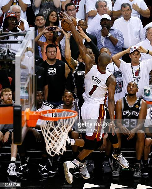 Chris Bosh of the Miami Heat blocks the last second threepoint attempt by Danny Green of the San Antonio Spurs as the Heat defeat the Spurs 103100 in...