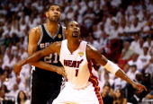 Chris Bosh of the Miami Heat boxes out Tim Duncan of the San Antonio Spurs during Game Three of the 2014 NBA Finals at American Airlines Arena on...