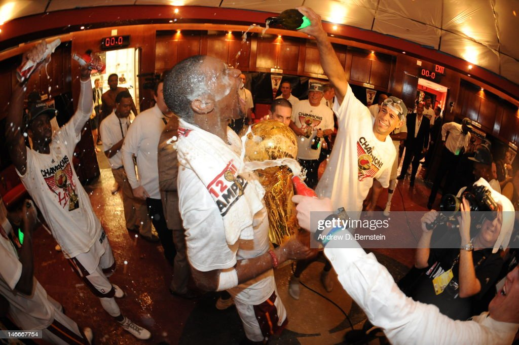 Chris Bosh #1 of the Miami Heat celebrates holding a Larry O'Brien Championship trophy in a locker room after winning Game Five of the 2012 NBA Finals between the Miami Heat and the Oklahoma City Thunder at American Airlines Arena on June 21, 2012 in Miami, Florida.
