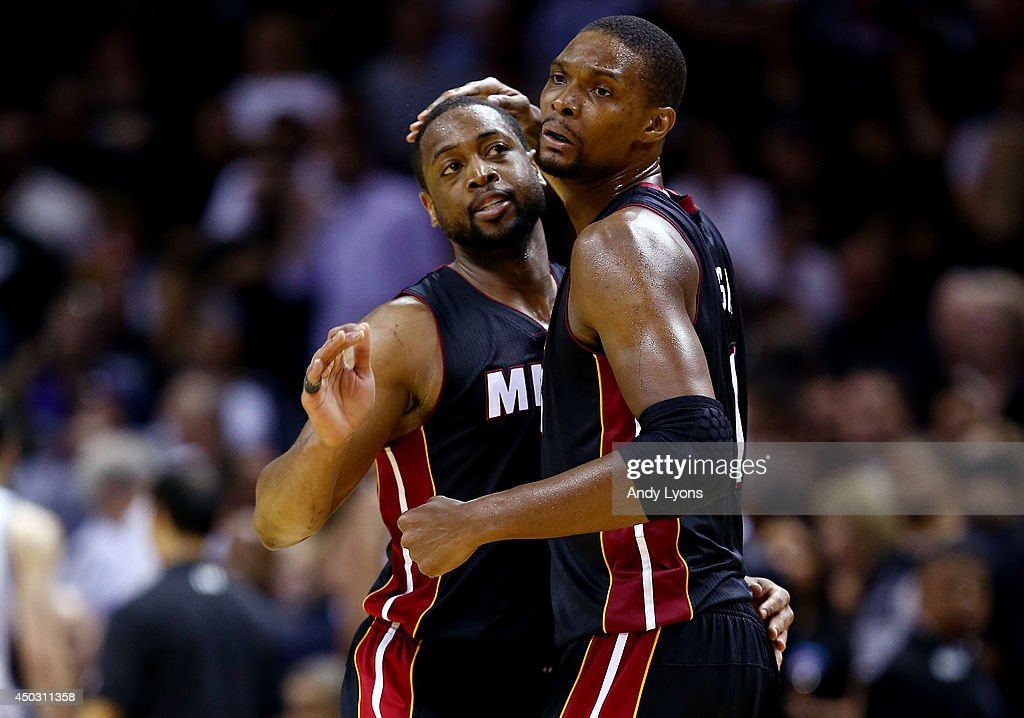 <a gi-track='captionPersonalityLinkClicked' href=/galleries/search?phrase=Chris+Bosh&family=editorial&specificpeople=201574 ng-click='$event.stopPropagation()'>Chris Bosh</a> #1 of the Miami Heat celebrates with <a gi-track='captionPersonalityLinkClicked' href=/galleries/search?phrase=Dwyane+Wade&family=editorial&specificpeople=201481 ng-click='$event.stopPropagation()'>Dwyane Wade</a> #3 against the San Antonio Spurs during Game Two of the 2014 NBA Finals at the AT&T Center on June 8, 2014 in San Antonio, Texas. The Miami Heat defeated the San Antonio Spurs 98-96.
