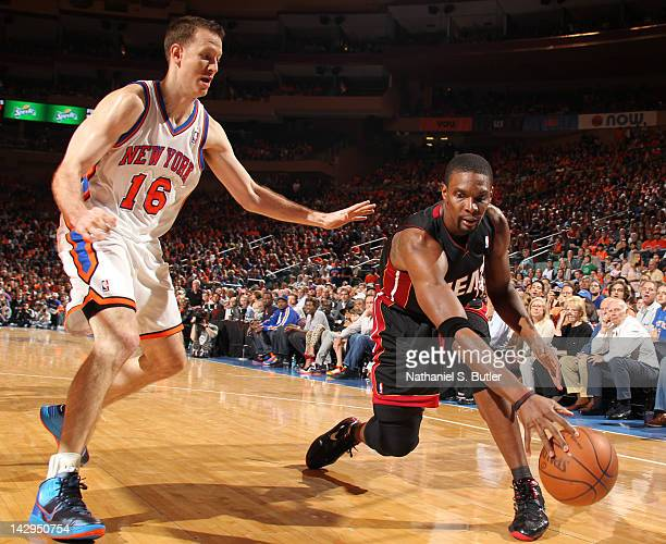 Chris Bosh of the Miami Heat controls the ball against Steve Novak of the New York Knicks during the game on April 15 2012 at Madison Square Garden...