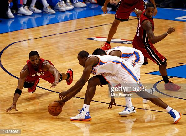 Chris Bosh of the Miami Heat dives for the ball against Serge Ibaka of the Oklahoma City Thunder in the first half in Game One of the 2012 NBA Finals...