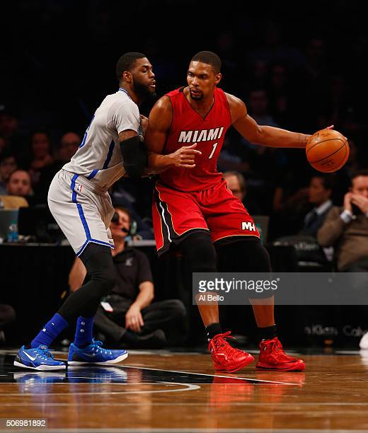 Chris Bosh of the Miami Heat dribbles against Willie Reed of the Brooklyn Nets during their game at the Barclays Center on January 26 2016 in New...