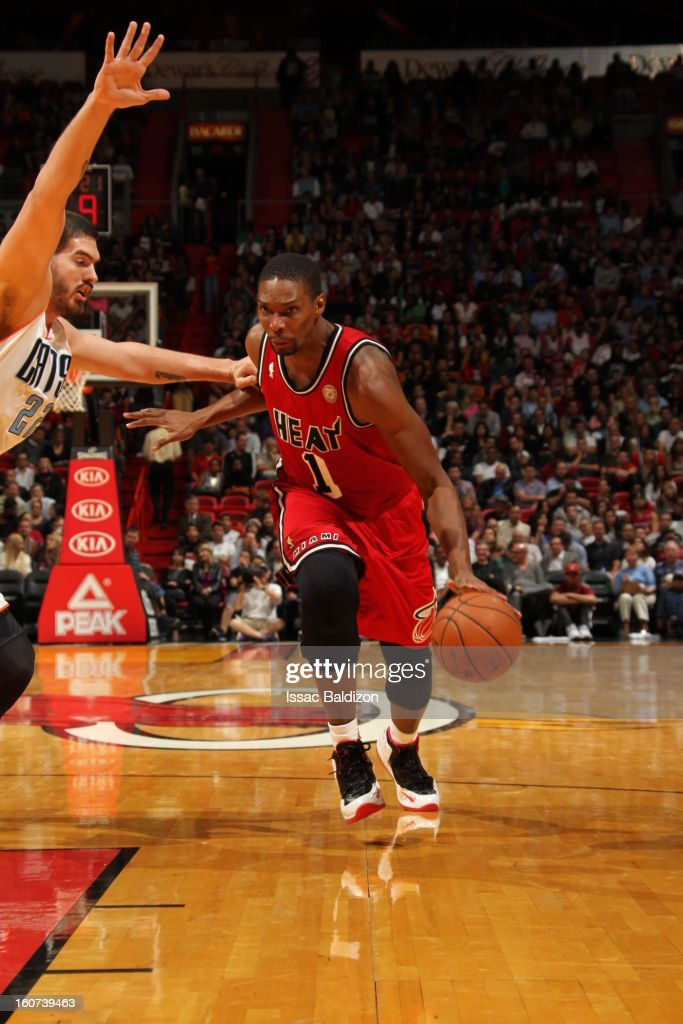 Chris Bosh #1 of the Miami Heat dribbles the ball to the hole against the Charlotte Bobcats during a game on February 4, 2013 at American Airlines Arena in Miami, Florida.