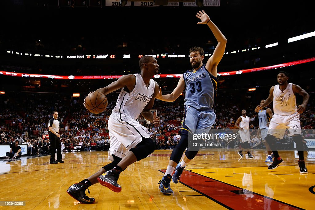 Chris Bosh #1 of the Miami Heat drives past Marc Gasol #33 of the Memphis Grizzlies at American Airlines Arena on March 1, 2013 in Miami, Florida.