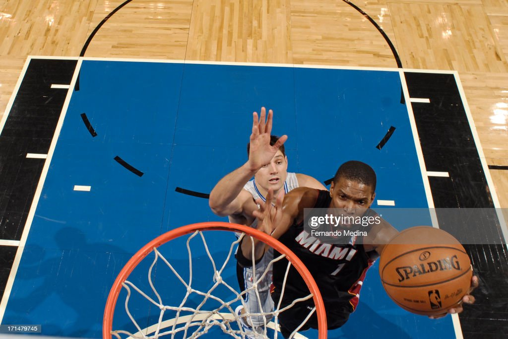 <a gi-track='captionPersonalityLinkClicked' href=/galleries/search?phrase=Chris+Bosh&family=editorial&specificpeople=201574 ng-click='$event.stopPropagation()'>Chris Bosh</a> #1 of the Miami Heat drives to the basket against Nikola Vucevic #9 of the Orlando Magic on December 31, 2012 at Amway Center in Orlando, Florida.