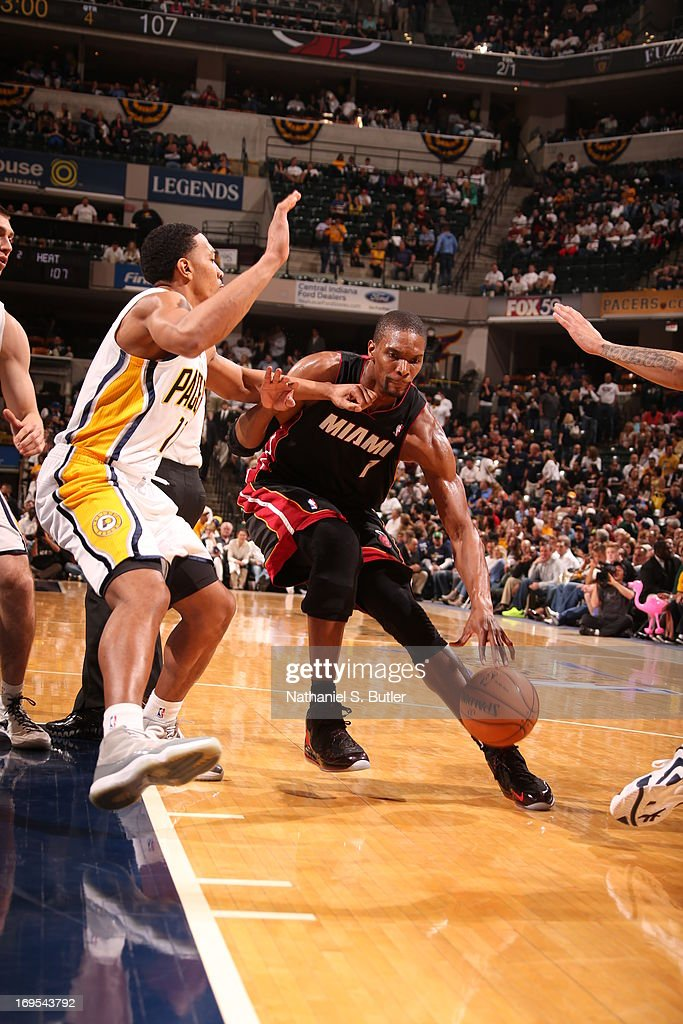 <a gi-track='captionPersonalityLinkClicked' href=/galleries/search?phrase=Chris+Bosh&family=editorial&specificpeople=201574 ng-click='$event.stopPropagation()'>Chris Bosh</a> #1 of the Miami Heat drives to the basket against the Indiana Pacers in Game Three of the Eastern Conference Finals during the 2013 NBA Playoffs on May 26, 2013 at Bankers Life Fieldhouse in Indianapolis, Indiana.