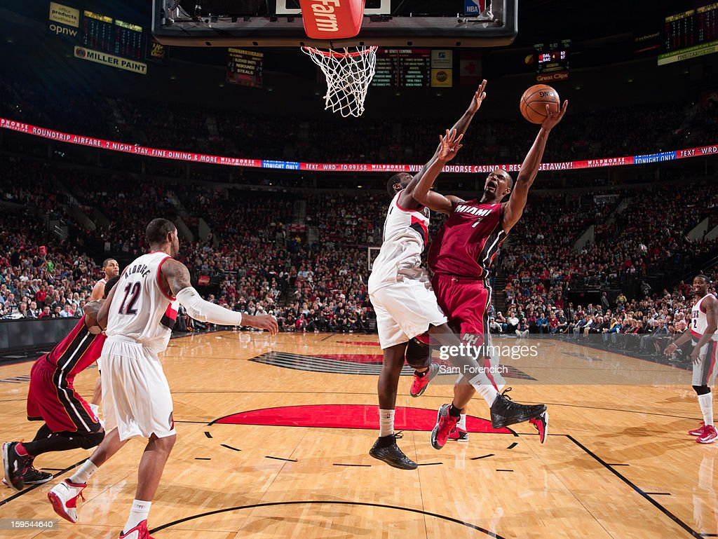 <a gi-track='captionPersonalityLinkClicked' href=/galleries/search?phrase=Chris+Bosh&family=editorial&specificpeople=201574 ng-click='$event.stopPropagation()'>Chris Bosh</a> #1 of the Miami Heat drives to the basket against the Portland Trail Blazers on January 10, 2013 at the Rose Garden Arena in Portland, Oregon.