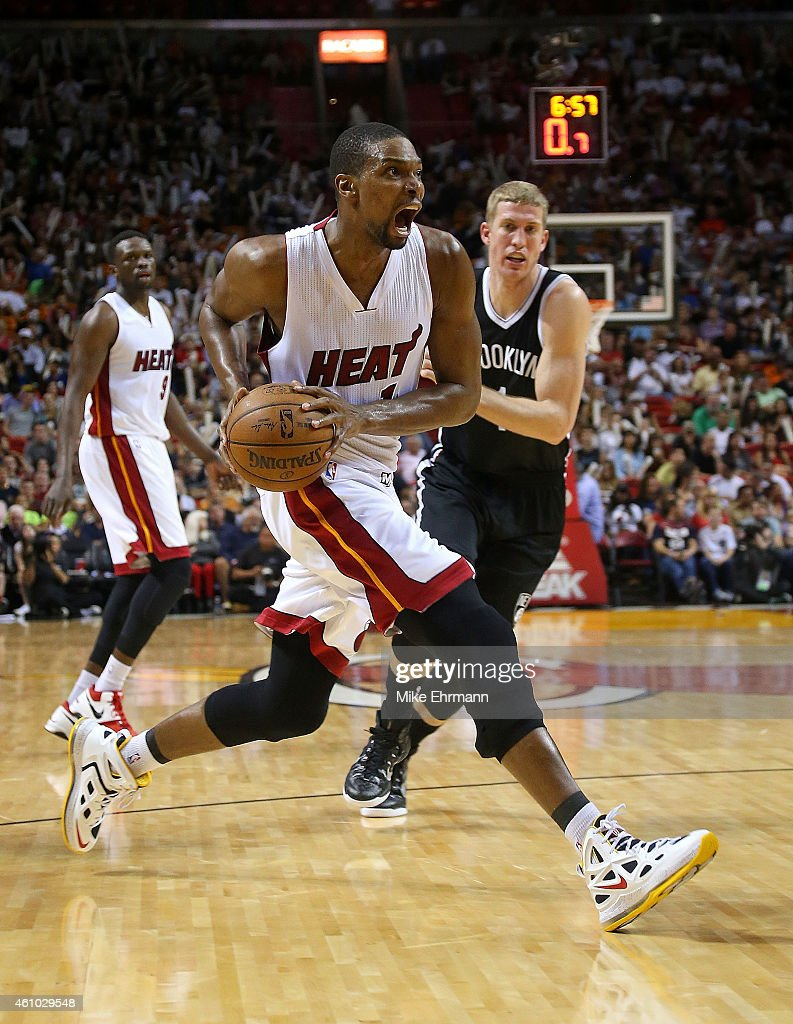 Miami heat basket - Chris Bosh 1 Of The Miami Heat Drives To The Basket During A Game Against