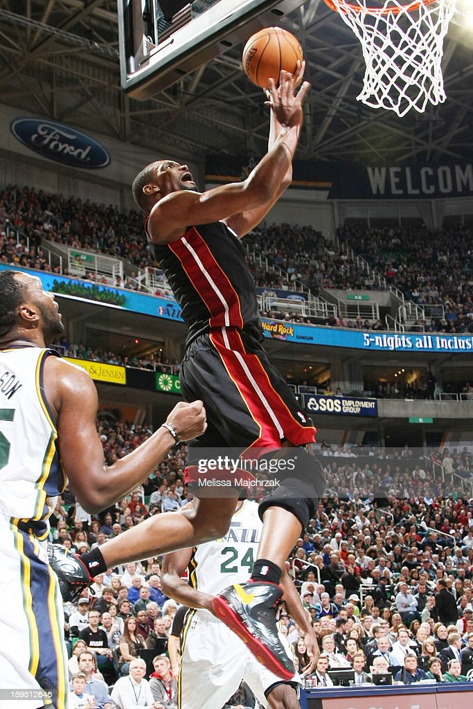 Chris Bosh #1 of the Miami Heat drives to the hoop against Al Jefferson #25 of the Utah Jazz at Energy Solutions Arena on January 14, 2013 in Salt Lake City, Utah.