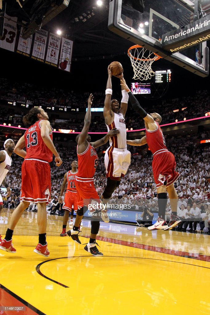 Chris Bosh #1 of the Miami Heat dunks against Joakim Noah #13, Luol Deng #9 and Carlos Boozer #5 of the Chicago Bulls in Game Four of the Eastern Conference Finals during the 2011 NBA Playoffs on May 24, 2011 at American Airlines Arena in Miami, Florida. The Heat won 101-93 in overtime.