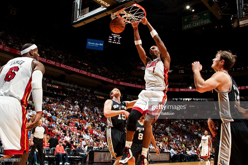 Chris Bosh #1 of the Miami Heat dunks against the San Antonio Spurs on November 29, 2012 at American Airlines Arena in Miami, Florida.