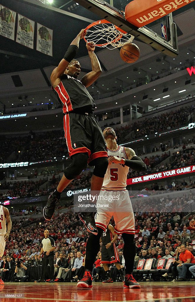 <a gi-track='captionPersonalityLinkClicked' href=/galleries/search?phrase=Chris+Bosh&family=editorial&specificpeople=201574 ng-click='$event.stopPropagation()'>Chris Bosh</a> #1 of the Miami Heat dunks over <a gi-track='captionPersonalityLinkClicked' href=/galleries/search?phrase=Carlos+Boozer&family=editorial&specificpeople=201638 ng-click='$event.stopPropagation()'>Carlos Boozer</a> #5 of the Chicago Bulls in Game Four of the Eastern Conference Semifinals during the 2013 NBA Playoffs at the United Center on May 13, 2013 in Chicago, Illinois. The Heat defeated the Bulls 88-65.