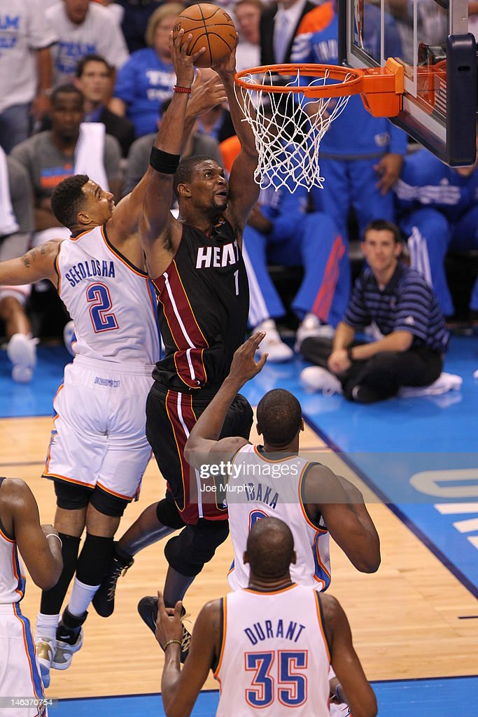 <a gi-track='captionPersonalityLinkClicked' href=/galleries/search?phrase=Chris+Bosh&family=editorial&specificpeople=201574 ng-click='$event.stopPropagation()'>Chris Bosh</a> #1 of the Miami Heat dunks the ball during Game Two of the 2012 NBA Finals between the Miami Heat and the Oklahoma City Thunder at Chesapeake Energy Arena on June 14, 2012 in Oklahoma City, Oklahoma.