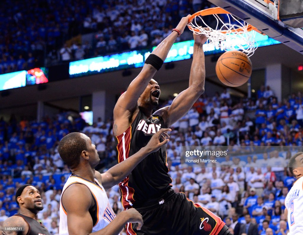 <a gi-track='captionPersonalityLinkClicked' href=/galleries/search?phrase=Chris+Bosh&family=editorial&specificpeople=201574 ng-click='$event.stopPropagation()'>Chris Bosh</a> #1 of the Miami Heat dunks the ball over <a gi-track='captionPersonalityLinkClicked' href=/galleries/search?phrase=Serge+Ibaka&family=editorial&specificpeople=5133378 ng-click='$event.stopPropagation()'>Serge Ibaka</a> #9 of the Oklahomia City Thunder in the fourth quarter in Game Two of the 2012 NBA Finals at Chesapeake Energy Arena on June 14, 2012 in Oklahoma City, Oklahoma.