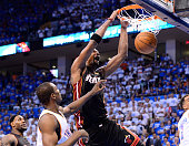 Chris Bosh of the Miami Heat dunks the ball over Serge Ibaka of the Oklahomia City Thunder in the fourth quarter in Game Two of the 2012 NBA Finals...