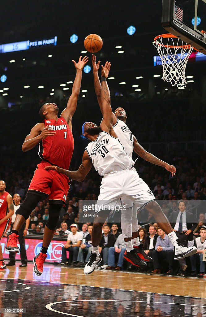 Chris Bosh #1 of the Miami Heat fights for a rebound against Reggie Evans #30. and Andray Blatche #0 of the Brooklyn Nets during their game at the Barclays Center on January 30, 2013 in the Brooklyn borough of New York City.