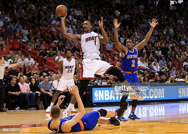 Chris Bosh of the Miami Heat fouls Kristaps Porzingis of the New York Knicks during a game at American Airlines Arena on January 6 2016 in Miami...
