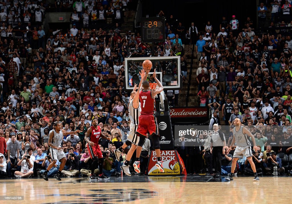 <a gi-track='captionPersonalityLinkClicked' href=/galleries/search?phrase=Chris+Bosh&family=editorial&specificpeople=201574 ng-click='$event.stopPropagation()'>Chris Bosh</a> #1 of the Miami Heat goes for a game-winning shot during the game between the Miami Heat and the San Antonio Spurs on March 31, 2013 at the AT&T Center in San Antonio, Texas.
