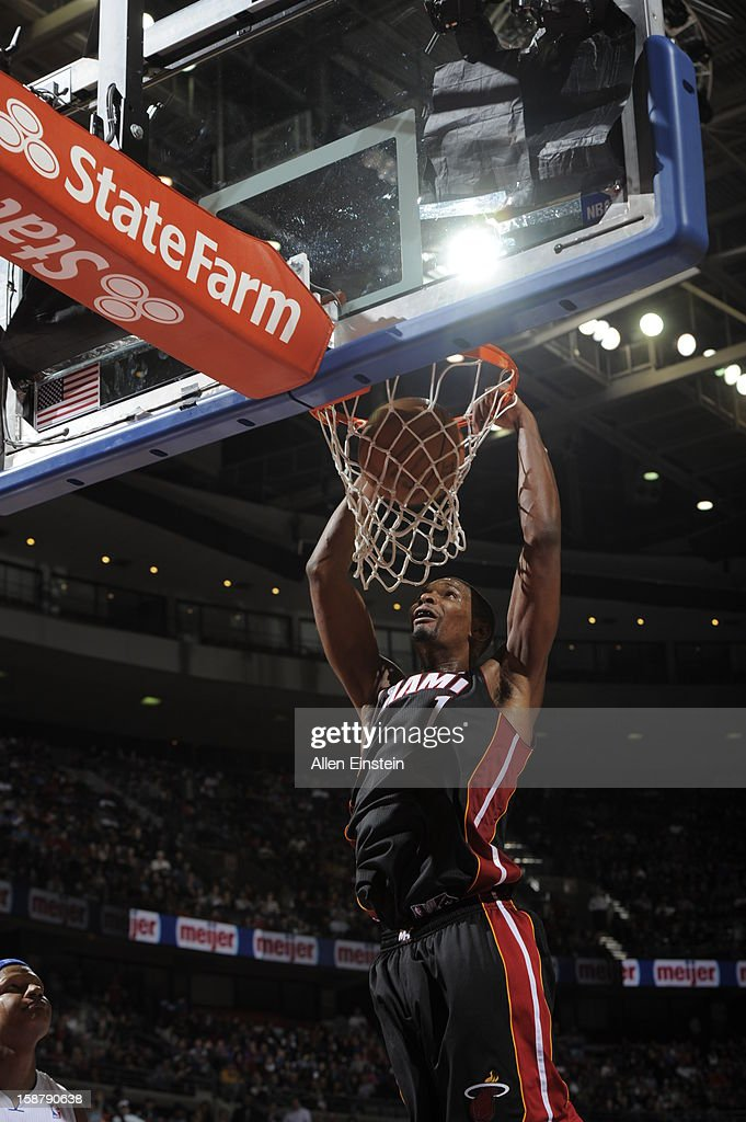 Chris Bosh #1 of the Miami Heat goes in for the slamdunk against the Miami Heat during the game on December 28, 2012 at The Palace of Auburn Hills in Auburn Hills, Michigan.